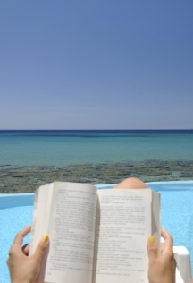 Reading a book by the pool, somewhere warm!