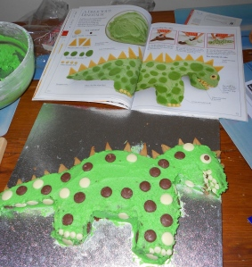 Dinosaur cake below recipe book