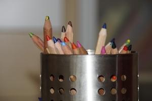 Coloured pencils in a pot