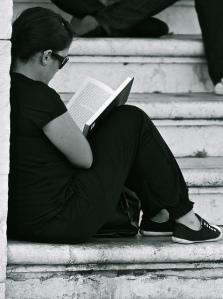 Reading a book by Pedro Ribeiro Simões